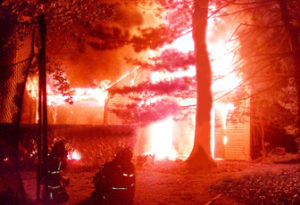 Fire Department fighting a house fire at night