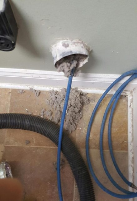 Cleaning a dryer vent with a rotating brush tool. Dryer Vent Cleaning Blog   Jacksonville Florida