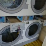 Bank of commercial laundry dryers.